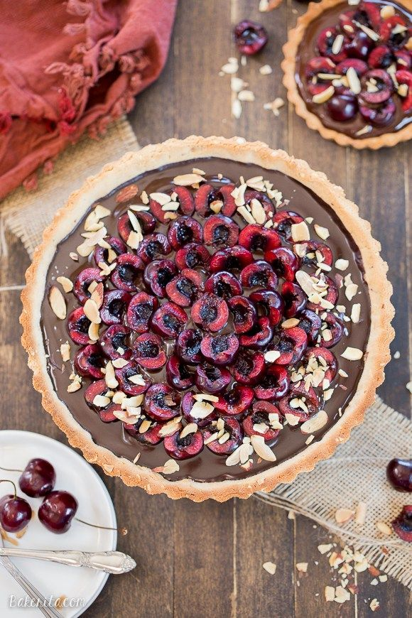 This Chocolate Cherry Tart has a toasted almond shortbread crust filled with silky chocolate ganache and fresh cherries! This gluten-free, Paleo, and…