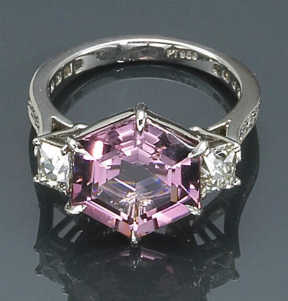 A pink tourmaline and diamond ring  centering a hexagon-shaped pink tourmaline; mounted in platinum