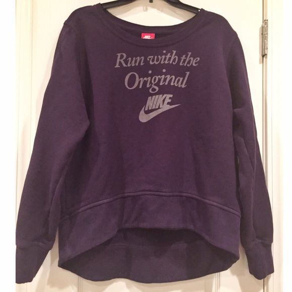 FINAL PRICE NWOT Nike Sweatshirt PRICE REDUCEDNWOT deep purple Nike Sweatshirt. The sweatshirt is high-low, which means it's shorter in the front than it is in the back! Want more pics??  Just comment below Nike Sweaters Crew & Scoop Necks