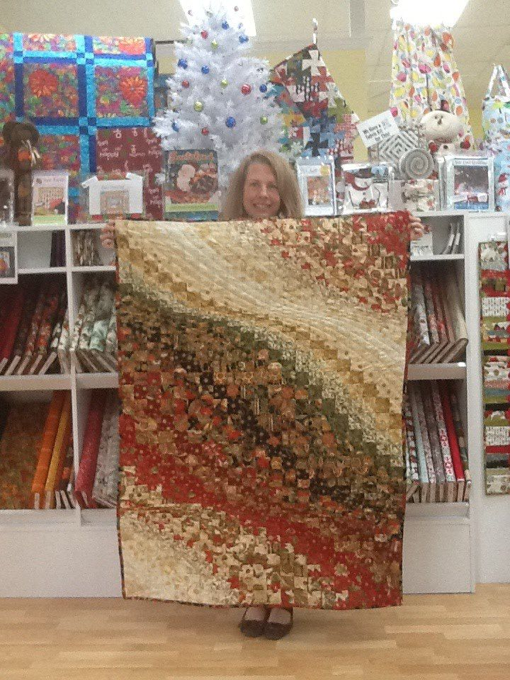 """Check out Monica's Bargello Christmas quilt! This is from the pattern """"I Used to be a Layer Cake"""", and yes, it is made using just one layer cake of precut 10"""" squares! Easy and beautiful.....way to go, Monica! Thanks for sharing that with us! — with Monica Hawke."""