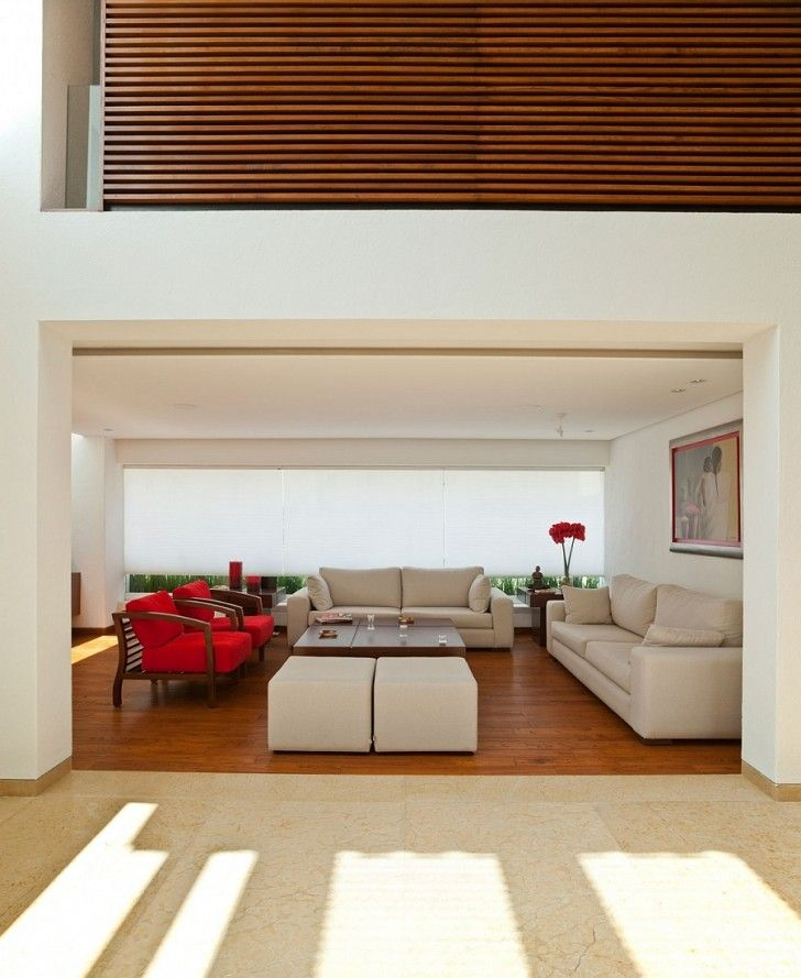 An Exclusive Living Room Design With Comfort Cream Sofa And Tantalizing Red Armchair Fascinating Concrete Porch Warm Bright Modern House In
