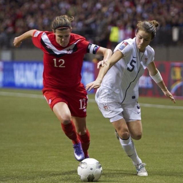 Canadian soccer superstar Christine Sinclair (L) led her nation to qualifying for the London Olympics this summer. She led the CONCACAF qualifying tournament with nine goals. Canada finished with a silver medal last Sunday after losing to the United States. (Rich Lam/Getty Images)/The Epoch Times
