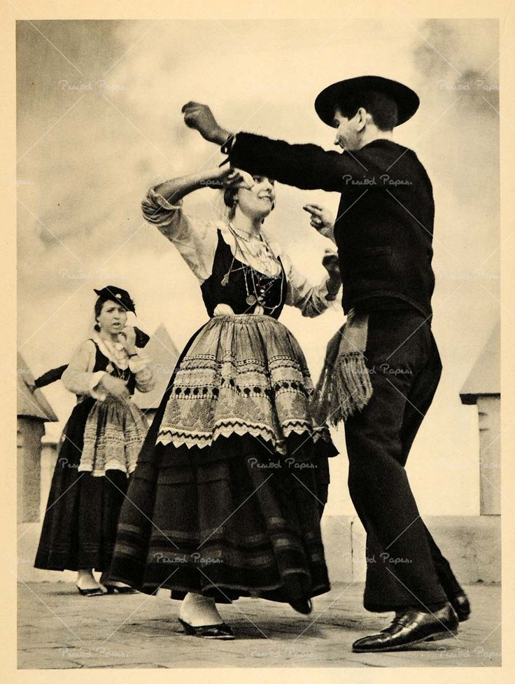 Traditional portugese dancing on the streets in portugal. They do this today!