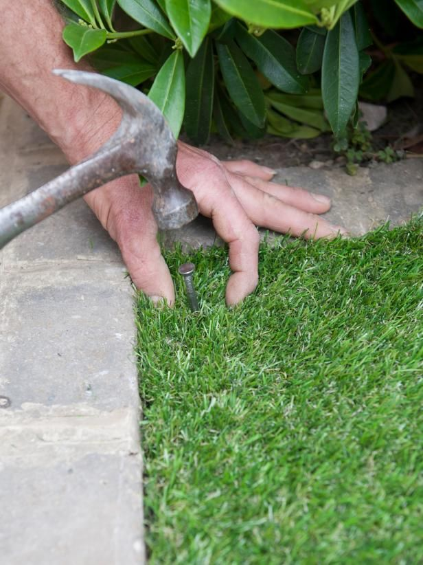 Learn how to lay artificial turf in your lawn space with this step-by-step landscaping guide from DIY.