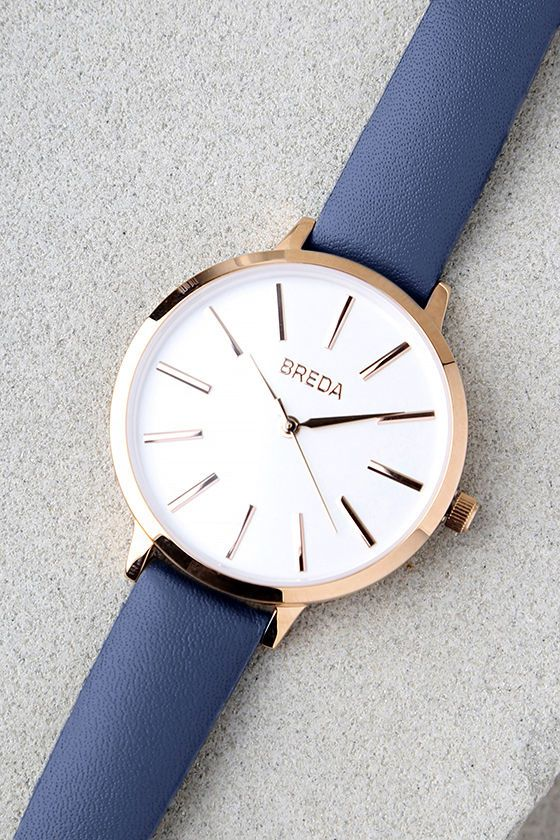 """Talk about perfect timing, the Breda Joule Navy Blue Leather Watch is here to perfect your minimally-chic look! This elegant women's watch features a round, rose gold-plated case with a white watch face, plus rose gold hands and time markers. Buckled, navy leather band measures 8.5"""" around with seven hole adjustments. Watch case measures 1.5"""" in diameter."""