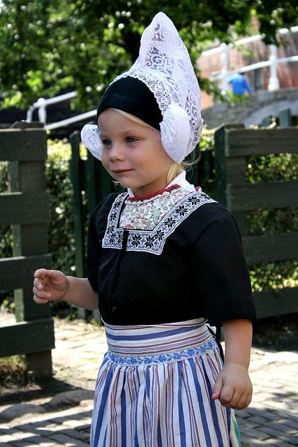 A young girl in the traditional costume of Volendam, Netherlands.