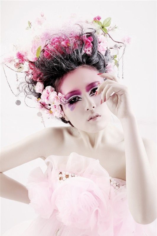 Beautiful pink make up. Tulle dress. Cherry blossom flowers in her haie