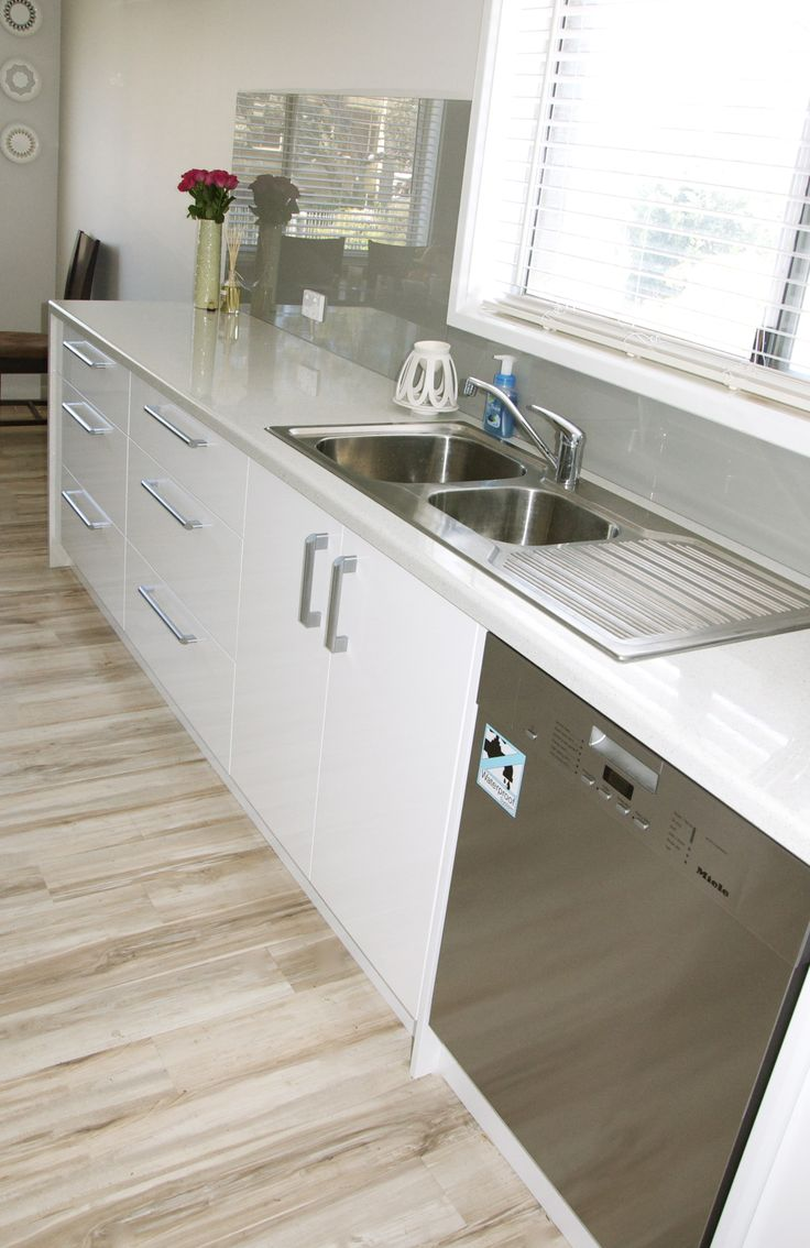Long galley style kitchens make great use of space in a narrow room