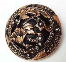 extraordinary Victorian domed metal button set with cut steel accents, floral motif