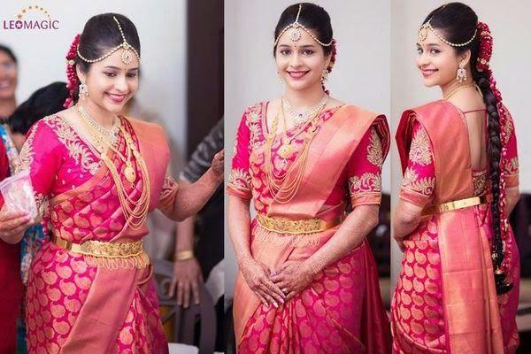 South Indian bride. Pink Kanchipuram silk sari.Temple jewelry. Braid with fresh flowers. Tamil bride. Telugu bride. Kannada bride. Hindu bride. Malayalee bride.