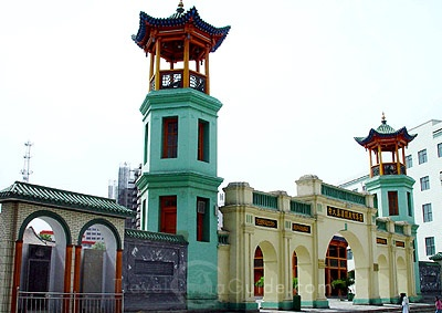 Dongguan Mosque,Xining, China. Restored recently, it was built in the 14th century and has colorful white arches along the outside of the wide building. It has a green and white dome and two tall minarets.
