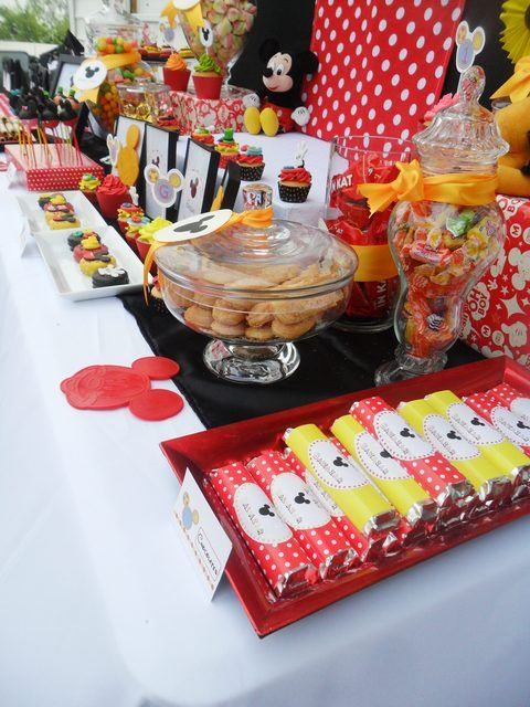 Mickey Mouse Party themed table and decorations.  Love the idea of printing labels for customizing items to fit the party theme.