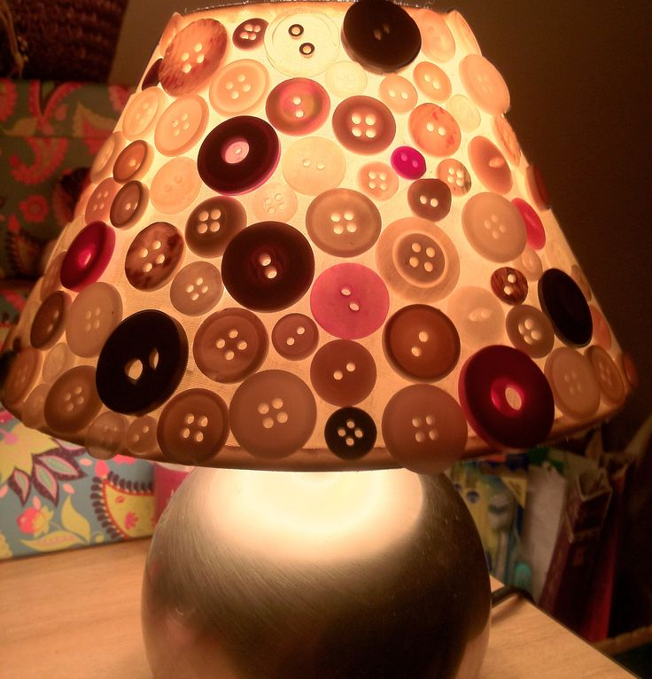 Button lampshade ~ I had a bag of odd buttons for years, and decided I would use them to cover the bedroom lamp & see what it ended up like.  I simply superglued them to the old cloth lampshade, one by one... Unfortunately I didn't have enough buttons to complete it, so had to do a button plea on Facebook! The overall effect is lovely when the light is dimmed, nice and relaxing for bedtime.  ;)