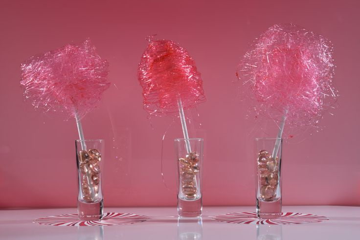 Learn how to make Spun Sugar Pops and watch your bubbly hot sugar cool to glass threads. Get this easy spun sugar recipe at The Finer Cookie.