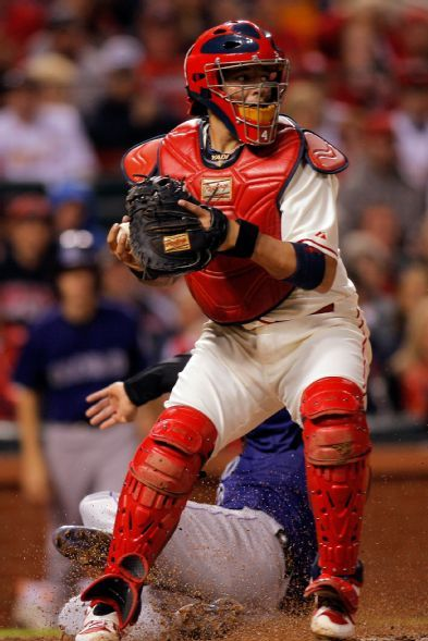 Yadier Molina prepares to throw to second base during a game against the Rockies. Cards won the game 5-4. 9-13-14