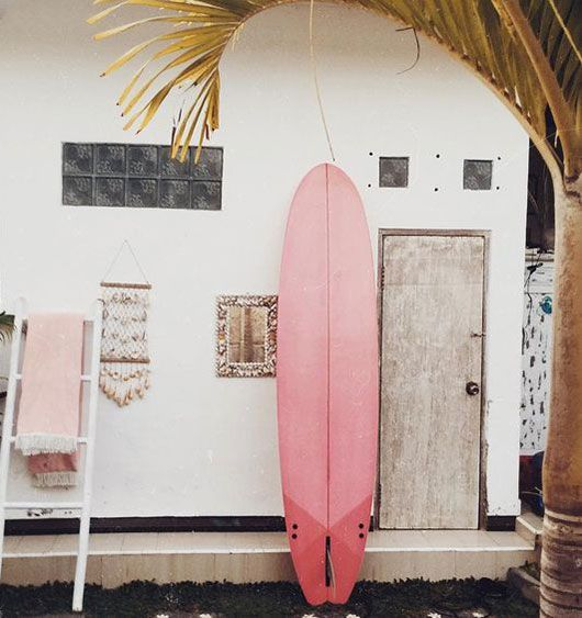 Pink surfboard + white walls