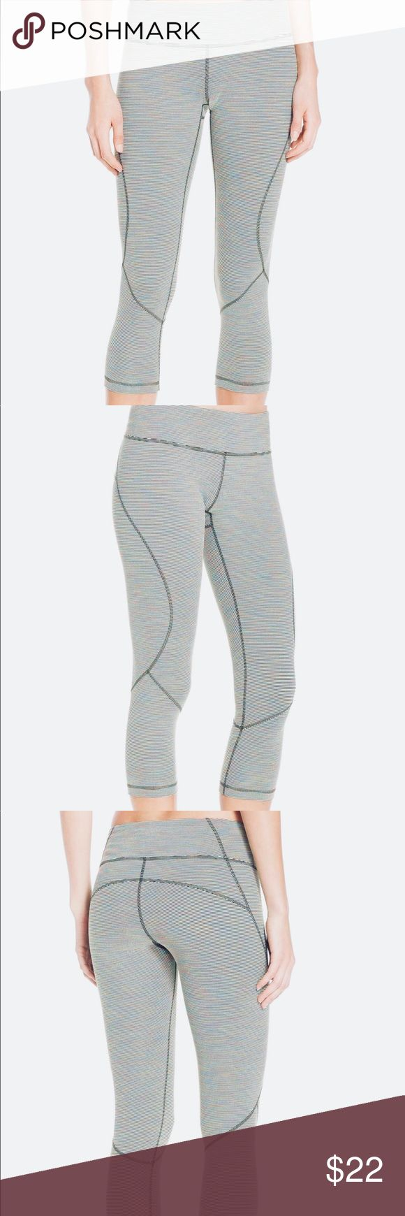 "ZELLA Live In Crop Leggings ZELLA Live In Crop Leggings (Medium)  Color: Black & White Stripes  Details & Care These lean, crop pants are ideal for working out or wearing out, cut from a stretchy, moisture-wicking knit and sewn with flatlock seaming for a comfortable, chafe-free fit.  Size Details: - medium - Runs small - M=8-10  Info: 20 1/2"" inseam 10"" leg opening 9"" front rise 13"" back rise   Other Info: Polyester/spandex. Machine wash cold, tumble dry low. Zella Pants Ankle & Cropped"