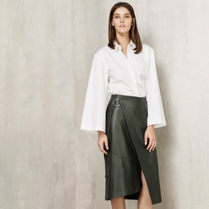 Model wears Autograph leather wrap skirt and white shirt