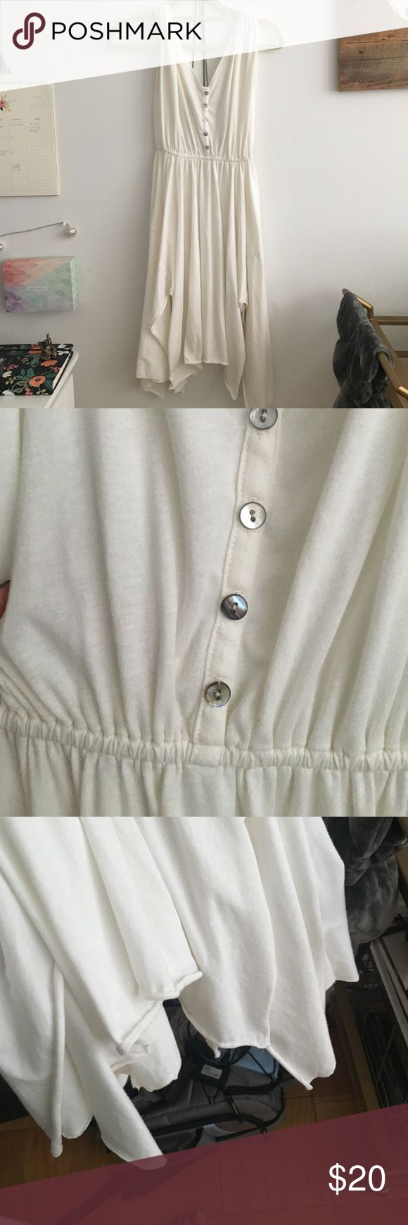 Free people white dress with shell buttons This is super cute free people beach dress, it's flowy at the bottom and has shell buttons. Size Xsmall but it is loose and would fit a small or medium as well Free People Dresses