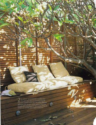 Wooden garden seating with cushions