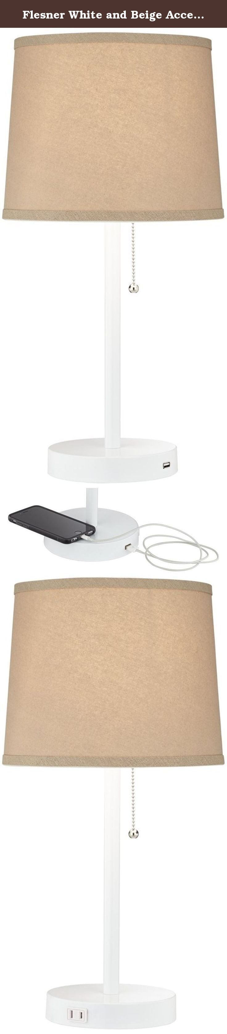 Flesner White and Beige Accent Table Lamp with USB Port. Charge your smart phone or tablet with this stylish and functional accent table lamp with a USB port in the base. A built-in utility plug lets you plug-in another device. The round base and body feature a white finish. A pull switch adds another convenient element making it the perfect addition for a desk or bedside table. - Contemporary table lamp with built-in outlet plug and a 1.0-A type USB port. - White finish base and pole…