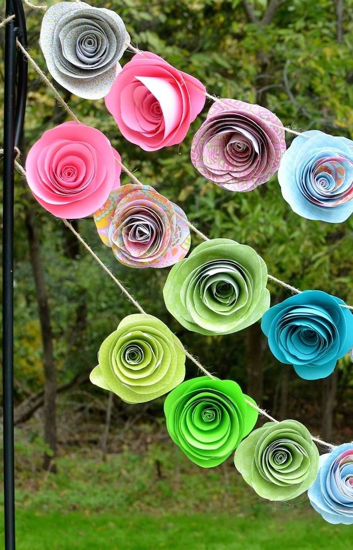 Cute diy paper flower banner! Garden of Eden themed birthday party with Lots of Really Cute Ideas via Kara's Party Ideas KarasPartyIdeas.com invitaion, decor, cake, favors and more! #gardenofeden #andandeve #forbiddenfruit #partystyling #partydecor #eventplanner (13)