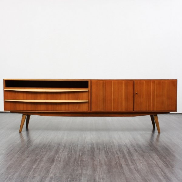 1950s ash sideboard with splayed legs and open shelf.