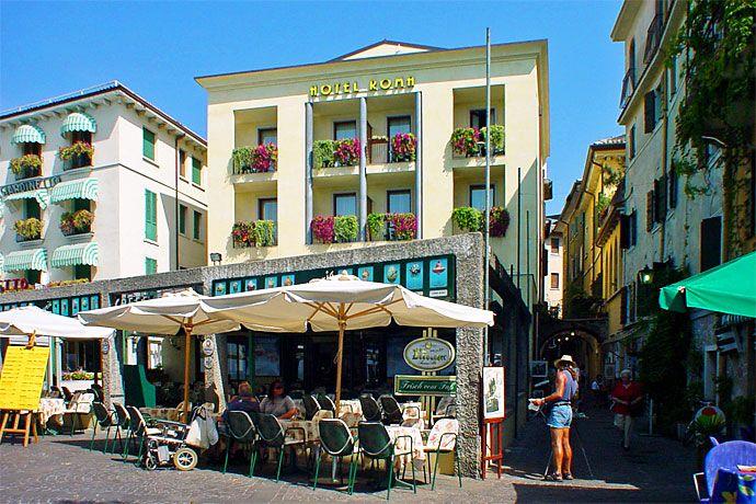 Hotel Roma - Garda ... Garda Lake, Lago di Garda, Gardasee, Lake Garda, Lac de Garde, Gardameer, Gardasøen, Jezioro Garda, Gardské Jezero, אגם גארדה, Озеро Гарда ... Welcome to Hotel Roma Garda. On the enchanting Riviera degli Olivi on Lake Garda there is a hotel where you can spend a pleasant relaxing holiday. Situated right in the centre of Garda, Hotel Roma has a marvellous view directly over the lake. The bedrooms have either a terrace or a balcony, an