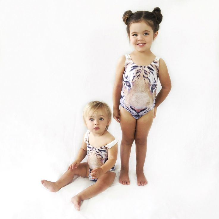 Super cool cat is one way to describe this Wild at Heart swimsuit. It's a trendy piece for a Mini fashionista! Cute Tiger face 3d image on the front and back. Such a pretty little one piece for an awesome little girl.