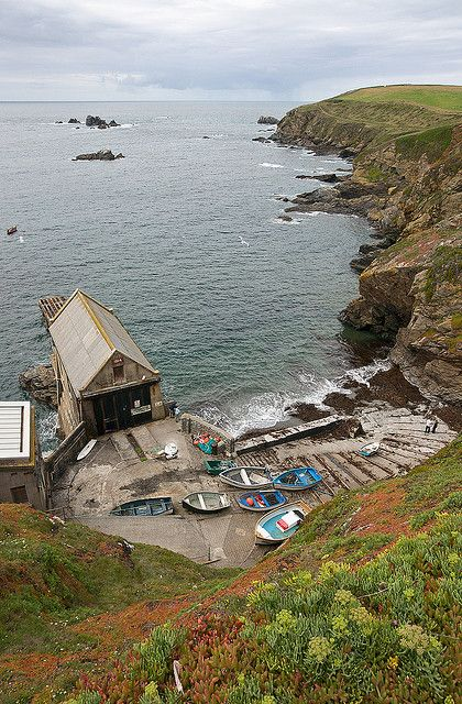 Polpeor Cove, Cornwall, the most southerly point on mainland Britain. The cove is dominated by the Old Lizard Lifeboat Station. The sand is dark grey & coarse & the beach is unsuitable for swimming.