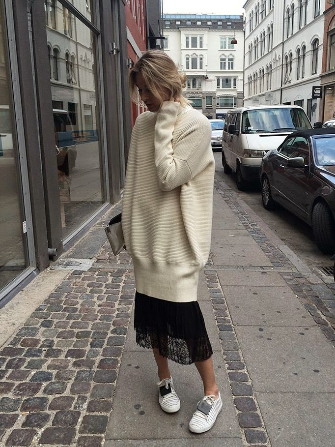 Autumn Style | Oversized cream knit sweater dress, black lace midi skirt & stripe Acne trainers | Camille Charriere | @styleminimalism