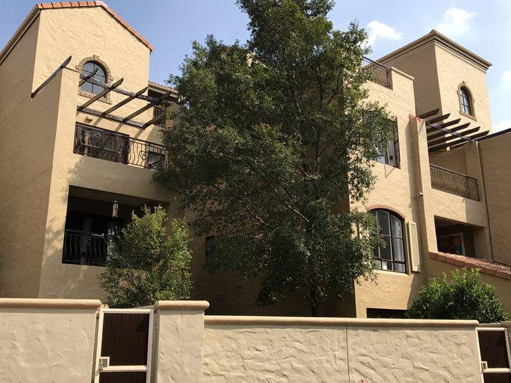 DELIGHTFUL BRIGHT SUNNY 2 BED 2 BATH APARTMENT CLOSE TO SANDTON CENTRAL WITH VIEWS OF THE SANDTON SKYLINE FROM THE UPSTAIRS TERRACE.  Set in lovely gardens with a pool, club house, tennis court and lawns with tables and benches to enjoy being outdoors under the trees this estate offers tranquillity with its numerous fountains. This bigger than average double volume apartment is situated in a prime position on Outspan Road, close to Sandton Central.