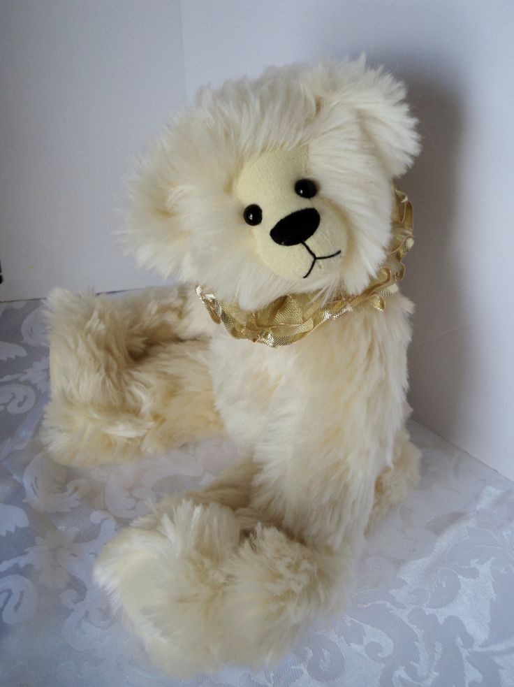 Sunshine - What we need after a very long winter!  She is 14 inches - made from Steiff-Schulte Pale Yellow German mohair.  German glass eyes and is fully jointed.