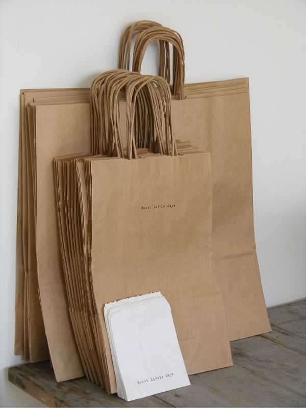 Simple packaging idea! I'm a huge fan of the brown bag package. tie a colorful ribbon around  and  attach a business card.