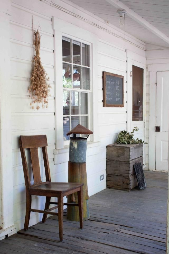 Great ol' farm house to browse through.  Love the clay pieces, the simplicity and of course the primitiveness of it all.  I'd love to have that porch too.