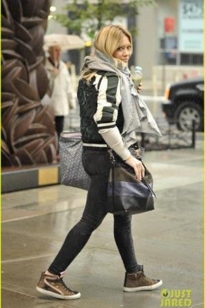 Hilary Duff wearing Golden Goose Leopard Suede Slide Sneakers, Goyard St Louis Tote and Proenza Schouler Python and Leather Bucket Bag.