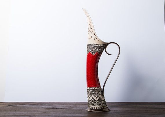 Vase with red decoration handmade pottery with glazed cover.    This is the perfect jug for wine or vase for flowers.    The handle is fired with