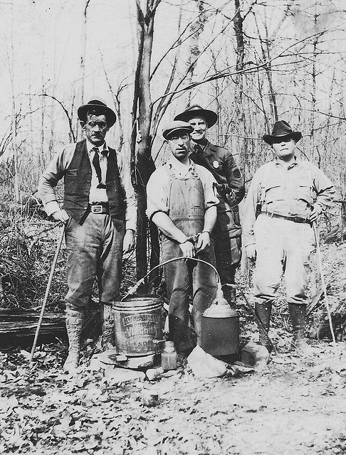 research the history of moonshine and The history of whiskey -  people who live on farms and who makes homemade whiskey use corn, just like making moonshine when whiskey was first invented from people they started out with charred white oak.