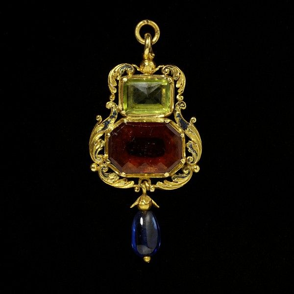 lace of origin:    England, Great Britain (made)  Date:    1540-1560 (made)  Artist/Maker:    Unknown (production)  Materials and Techniques:    Enamelled gold, set with a hessonite garnet and a peridot, and hung with a sapphire