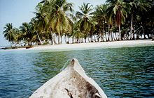 Sleeping in hammocks in The San Blas Islands of Panama are an archipelago comprising approximately 378 islands and cays, of which only 49 are inhabited.[1] They lie off the north coast of the Isthmus of Panama, east of the Panama Canal.[2] They are home to the Kuna Indians and a part of the comarca (district) Guna Yala (also spelled Kuna Yala) along the Caribbean coast of Panama. The area is popular for sailing, as it is known for its beauty and lack of hurricanes.[