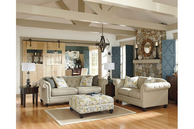 White couch and loveseat with patterned footrest for your living room design
