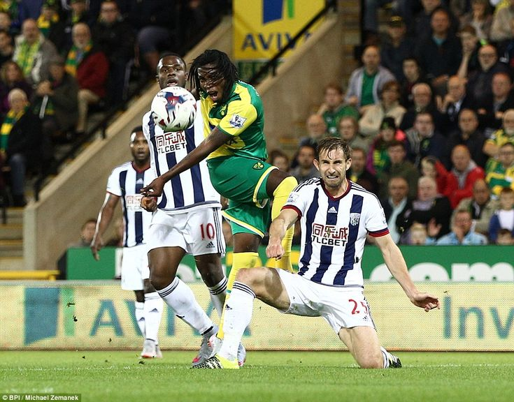Norwich City's Dieumerci Mbokani takes aim at goal as he looks to get the better of the West Brom defence in the Capital One Cup