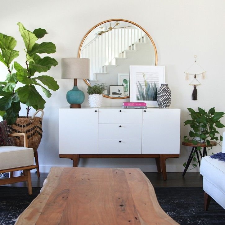 Family Friendly Bohemian Eclectic Kitchen Becki Owens Design. Raw-edge coffee table, midcentury console, oversized brass mirror, fiddle-leaf fig plants, and vintage textiles.