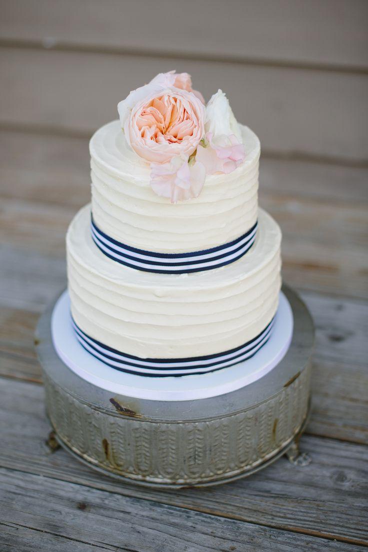 Nautical blush and navy buttercream wedding cake
