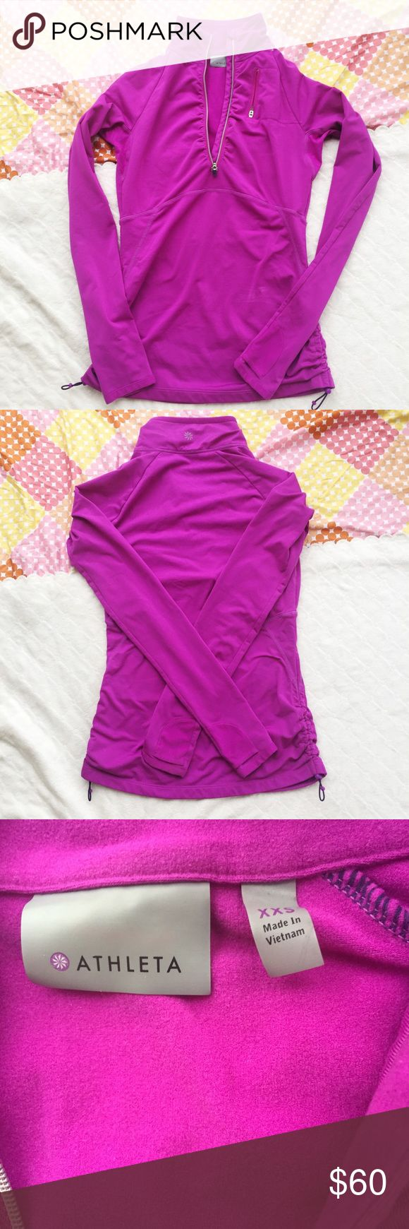 "XXS / Athleta pink half zip athletic jacket Pink half zip athletic pullover. 83% polyester + 17% spandex. Ruched at the side w/ drawstring ties to adjust fit. Has two small pockets at the wrists & a zip pocket near the collar.   SIZE: XXS waist: 14"" sleeve: 27"" length: 29""  ❌ no trades ✔️offers welcome! ❣️add to bundle for **discounted** shipping offer! Athleta Jackets & Coats"