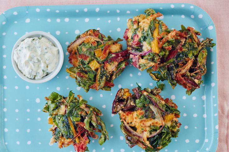 Veggie fritters are a bit of a mind game because they have a magical way of making you forget that you're actually eating vegetables. That's because the best fritters aren't just packed with veggies — they're also enhanced with cheese, herbs, and spices. Then there's the brilliant method of pan-frying them, making them nice and crispy. Everyone can agree on crispy.