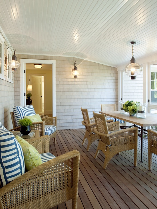 natural materials, beadboard ceiling.  nautical stripes on cusions with accent cusion for pop of colour.  light fixtures