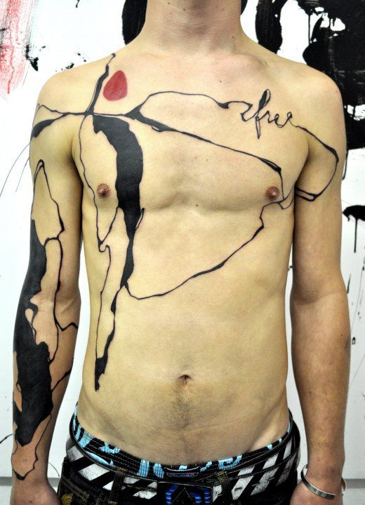 An abstract tattoo by tattoo artist Musa that looks as though someone has spilled ink all over this guy