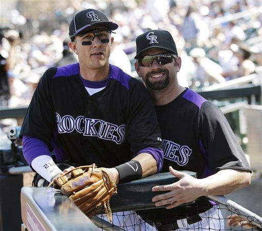 Colorado Rockies' Todd Helton, right, smiles next to teammate Troy Tulowitzki before a spring training baseball game against the Chicago Cubs, Thursday, March 15, 2012, in Scottsdale, Ariz. (AP Photo/Marcio Jose Sanchez)