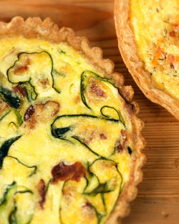 Ribbons of zucchini mingle with bacon, fresh thyme, and Gruyere cheese in this rich quiche.